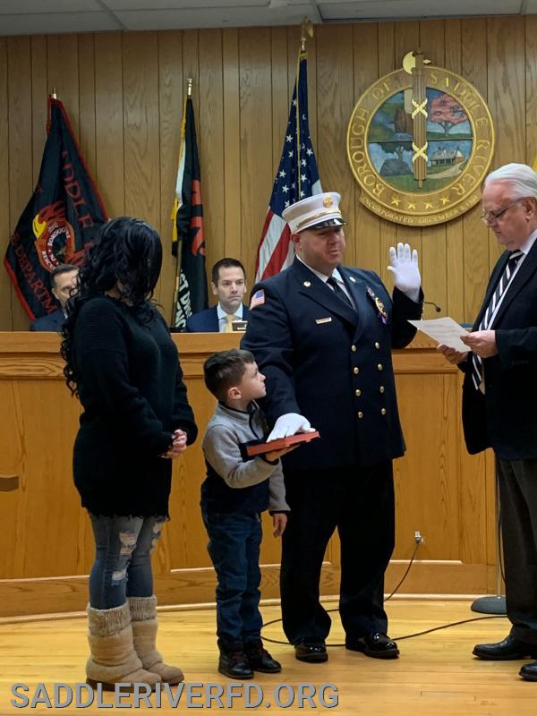 Chief Salvatori (1130) being sworn in by Mayor Al Kurpis.
