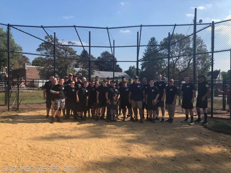 Saddle River PD and FD in a group photo after there annual softball game. Final Score SRFD 19 - SRPD 18